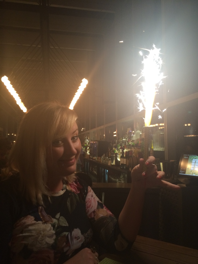 Miss S surprising me with a sparkler and a rousing version of 'Happy Birthday'. Ignore the glowing antlers I seem to have acquired...